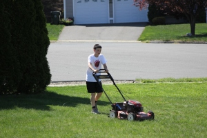 Kevin mowing lawn