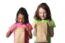girls with brown bag lunches